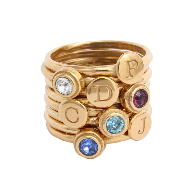 stacked rings in gold for mom of 4