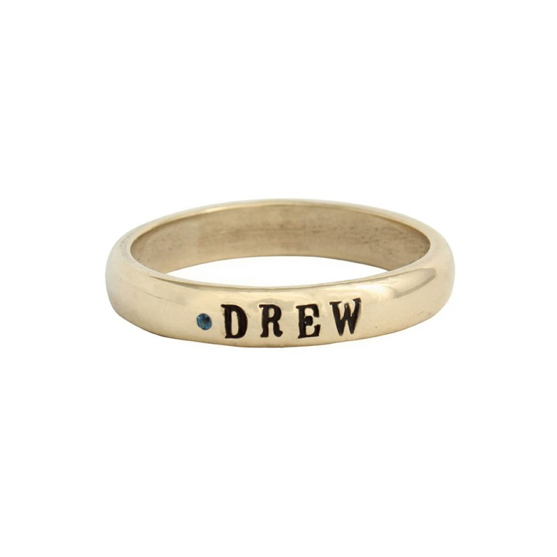 Gold stacked name ring on Model