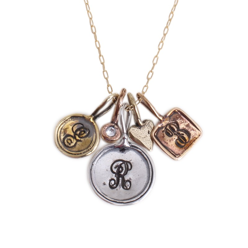 initial charm necklace with gold, rose gold and silver charms