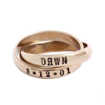 family name ring in gold with birthdate