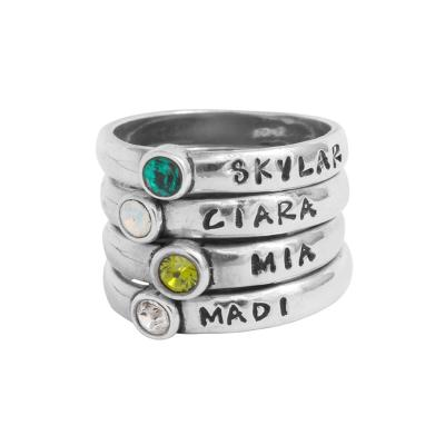 four stackable birthstone rings in silver