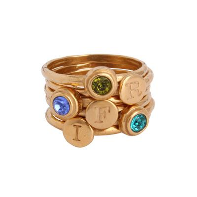 3 stone mothers ring stacked in gold