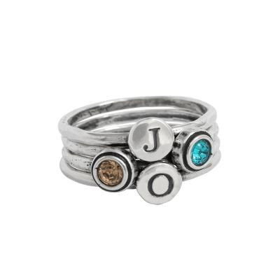 stackable birthstone and initial rings in silver