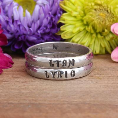 silver children's name rings stacked