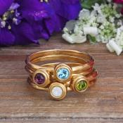 rings stackable in gold with birthstones